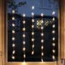 Kép 2/7 - 50 LED-es csillag fényfüggöny, hálózati adapteres, meleg fehér